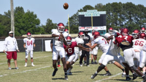 Demons, others seek gains during spring football sessions