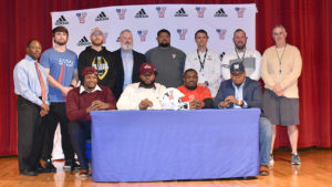Four from Veterans sign football scholarships
